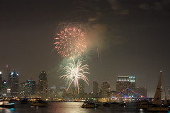 San Diego Skyline Under the Fireworks (TallCJ) Tags: california usa holiday night canon bay sandiego fireworks 100v10f fourthofjuly independenceday extendedexposure sandiegobay blueribbonwinner 92101 supershot mywinners anawesomeshot superaplus aplusphoto amazingshots ithinkthisisart diamondclassphotographer betterthangood yourpreferredpicture rebelxsi absolutelystunningscapes abovepar 742008 07042008