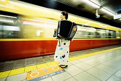 Limited Express (troutfactory) Tags: musician music motion film japan speed train underground subway kyoto voigtlander rangefinder accordion motionblur   kimono analogue agfa  kansai 15mm bessal keihan   heliar limitedexpress  vista400 wideanlge   shijostation