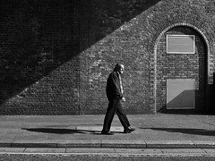 I walk alone (ro_nya) Tags: light shadow bw london walking interestingness solitude candid explore waterloo ronya ricohgx200