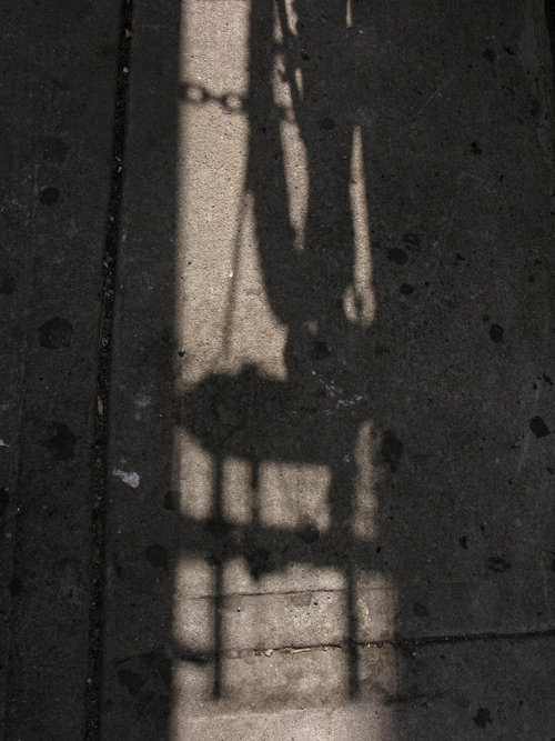 a shadow on a 37th Street sidewalk, Manhattan, NYC