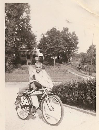 BOY ON SCHWINN BIKE DELIVERING PAPERS 1955
