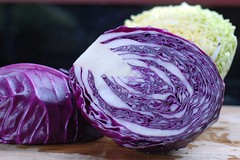 Purple and green sweet cabbage coleslaw with pecans, apples, and currants