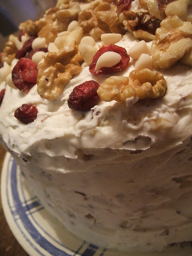 carrot cake with toasted hazelnut/cream cheese frosting decorated with walnuts,cranberries and white chocolate chips