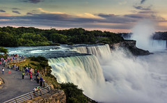 enjoy the falls (Wolfgang Staudt) Tags: travel blue panorama usa newyork ontario water colors beautiful yellow fog wow wonderful river lights niagarafalls boat nikon holidays rocks waves darkness nikond70 availablelight sigma waterfalls horseshoe wilderness lovelovelove reflexions vacancy wolfgang americanfalls spotlights peopleschoice niagarariver travelphotographie sixsixsixclub wolfgangstaudt staudt sigmaaf356328300dgmacro superaplus aplusphoto irresistiblebeauty favemegroup6 superhearts themawasserfoto colourartaward artlegacy nikonflickraward grouptripod