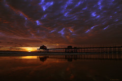 The Calm Before the Storm (Yobs) Tags: california sunset usa reflection silhouette landscape geotagged photography smithsonian photo photocontest huntingtonbeach stormclouds smithsonianchannel aerialamerica