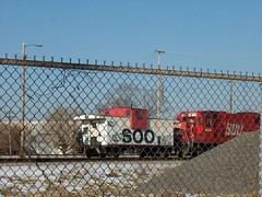 Former Soo Line equipment behind a fence. Schiller Park Illinois. January 2007.