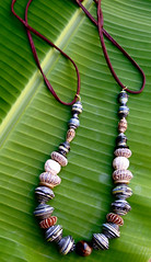ethical necklace (Mzuri beads) Tags: bananaleaf barkcloth cowhorn paperbeads ethicalfashion ribbonnecklace recycledjewelry fairtradejewelry naturalbeads fairtradebeads ugandanbeads ecojewellery ethicalbeads mzuribeads ugandanjewelry kirstiemaclean