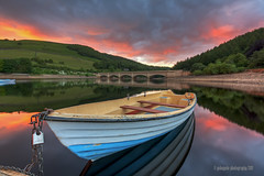 not shaken nor stirred (gobayode photography...times) Tags: reflections landscape boat derbyshire canoe redsky fishingboat ladybowerreservoir ladybower highpeaknationalpark colorphotoaward derbyshirelandscapes upperderwent ashoptonbridge boatonglass boatmirror ashoptonderbyshire howdenwaters