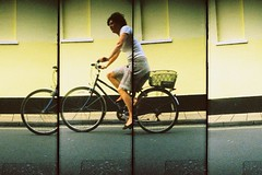 Cycles By... (Trapac) Tags: uk england people woman film bicycle yellow four cycling spring lomo xpro lomography crossprocessed supersampler cyclist kodak 4 slidefilm plasticfantastic cycle oxford blogged elitechrome oxfordshire plasticcamera 400iso kodakelitechrome wmh omo northparade flickrdayout supersamplerroll13 bloggedwithlink bloggedwithlinknotinformed withkatemellershmehslithytoves