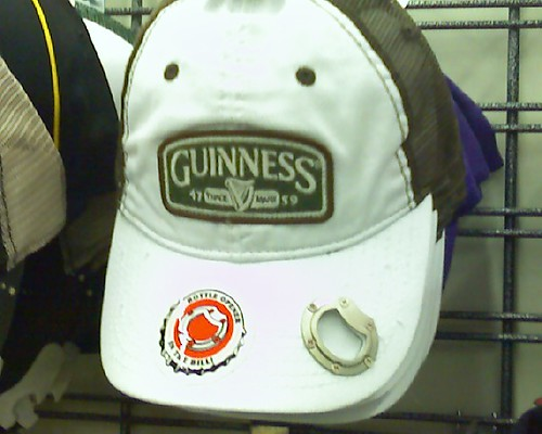 Guinness cap with a bottle opener in the bill. Perfect for DUI photos.