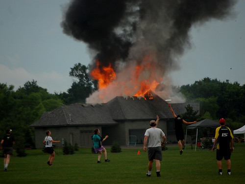house on fire during frisbee game, i think
