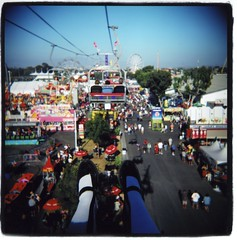 alice at the fair (Claire Marie Vogel) Tags: california county carnival blue sky people orange costa ski color 120 film feet socks analog square photo claire holga high shoes lift alice air flash mary border fair photograph medium format oc knee wonderland crowds mesa colorflash vogel janes sloppy kneehighs kneehigh