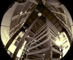 stairway up into the man's tower (Ivyerimenta) Tags: city party bw white man black art festival rock sepia stairs desert nevada playa fisheye burningman blackrockcity burning event brc bm northern theman artinstallation burningman2008
