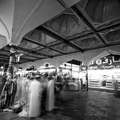 Souq (Khaled A.K) Tags: longexposure people blackandwhite bw night shot market ghosts sa jeddah saudiarabia khaled bnw ksa saudia kashkari