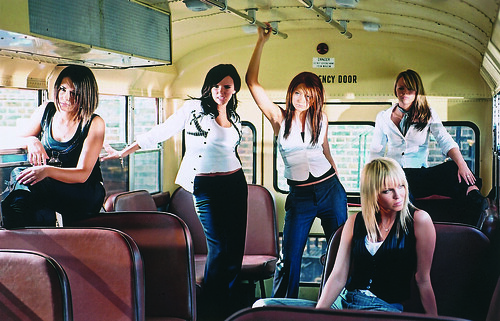 There are few things more attractive than Girls Aloud looking bored on a bus.
