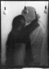 F e e l i n g . T o u c h i n g . L o v i n g (Polly Bird Balitro) Tags: people motion bird mamiya film me loving analog darkroom mediumformat myself kissing long experimental dancers dancing time doubleexposure double lovers sheets polly hp5 ghosts contact feel