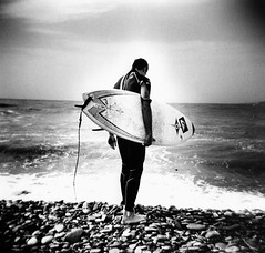 Banzai beach - back portrait 2 (massi_pugliese) Tags: sea portrait blackandwhite mer white black 120 film beach square holga lomography surf mare waves kodak grain wave surfing 66 squareformat bianco nero spiaggia biancoenero quadrato onde 400iso tavola santamarinella grana punctum palabra monart pellicola kodaktrix400 analogico audel spalle photographia 123bw medioformato bwart backportrait artlibre autaut banzaibeach aplusphoto independentphotos ilfordwarmtone kubrickslook cartabaritata massimilianopugliese massipugliese