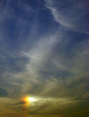 Glint of Color (ginfox) Tags: blue red sky orange white color yellow clouds rainbow glow bright florida piece shining section