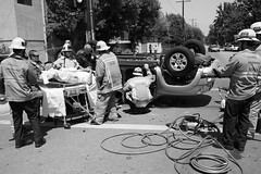 LAFD personnel provide care at a traffic collision. © Photo by Michael Corral. Click to view more...