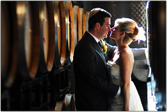 Caught Kissing (Extra Medium) Tags: groom bride candid jewishwedding caskroom barrelroom lafondwinery losangelesweddingphotographer jenniferfoster top20jewish santabarbaraweddingphotographer notreallycandid venturacountyweddingphotographer camarilloweddingphotographer venturaweddingphotographer malibuweddingphotographer