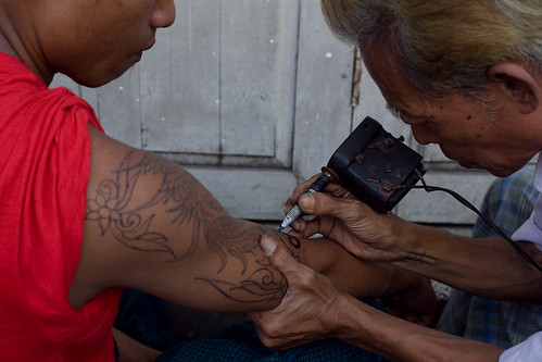 Street tattoo in Rangoon, Burma.