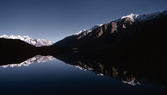 Dawn at Chandertal lake, Spiti (sapru) Tags: blue sky mountain lake reflection sunrise trek reflections landscape dawn photo amazing still cool fantastic quiet peace horizon group lakes relaxing restful calming surreal floating peaceful tranquility calm silence harmony serenity serene dreamlike hush reflexions stillness tranquil himachal himalayas balanced poised spiti gentle daybreak soothing calmness treks quietness comforting himachalpradesh composed the otherworldly illusory unruffled chandertal untroubled unperturbed lahaul chandrataal lahualspiti lahual aplusphoto unworried firstrays trancelike unlimitedphotos lahualandspiti lahaulandspiti artofimages chandertallake lakesinlahaulandspiti lakesinhimachal treksinhimachal flickraward