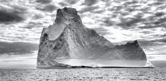 Iceberg ahead! (wili_hybrid) Tags: ocean trip travel sea summer vacation blackandwhite bw white holiday black cold ice nature water landscape geotagged outside outdoors photo yahoo high topv555 nikon europe flickr european exterior dynamic photos outdoor north picture dramatic august pic arctic journey greenland wikipedia imaging nordic iceberg d200 rts scandinavia northern drama mapping 2008 boattrip range geotag tone hdr scandinavian hdri photomatix nikond200 arcticsea tonemapped tonemapping tasiilaq highdynamicrangeimaging randomtravelerssociety year2008