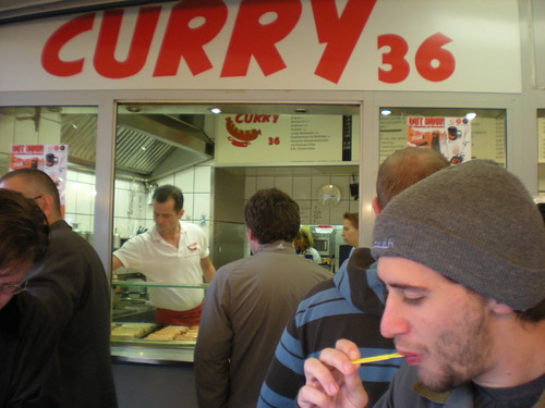 Sean enjoying a sausage and fries at Curry 36, a food stall in Berlin, Germany.
