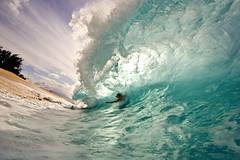 Blocking Out the Sun ( KristoforG) Tags: ocean blue 20d beach sports water canon photography eos hawaii sand surf break pacific action tube barrel wave tsunami shore northshore housing custom 2008 tidal 1022mm gellert keiki shorebreak kristofor toob kristoforgellert