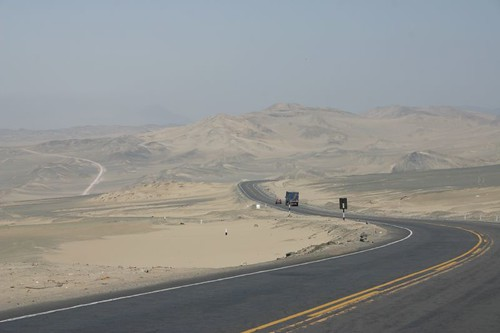 A rare curve and incline in the desert road. South of Chimbote, Peru.