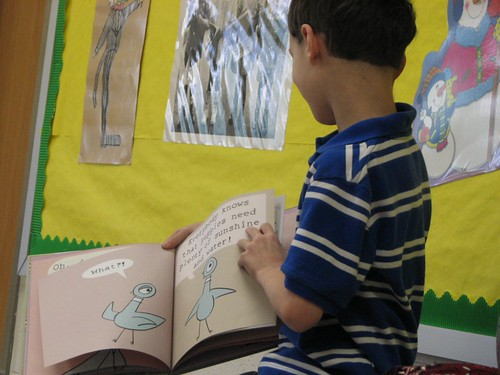 Son #1 reading to son #2's class