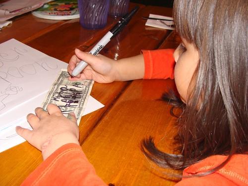 Mina signing her dollar