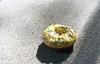 Day 154/365 - Doughnut on the Floor (Great Beyond) Tags: shadow food color slr film june yellow analog 35mm project colorful shadows floor image kodak sweet iso400 ishootfilm krispykreme sprinkles 35mmfilm 400 doughnut pastry 365 tamron doughnuts 3000v sprinkle latent c41 28200mm portra400 2011 kodakportra400 project365 canoneosrebelk2 filmisnotdead canonrebelk2 latentimage tamronaf28200mm june2011 dayofthedonut dayofthedoughnut krispykremesucks