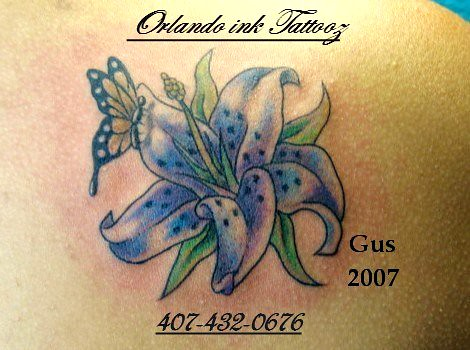 flower butterfly tattoo by Orlando Ink Tattoos From Orlando Ink..