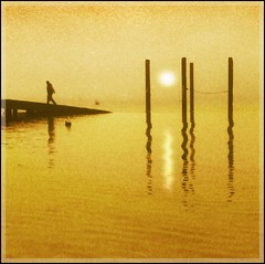 leaving you in my dreams (adrians_art) Tags: morning winter red people orange sun mist film water monochrome weather yellow fog sunrise reflections mono bravo silhouettes delta rivers scanned ilford 400asa firstquality alarecherchedutempsperdu mywinners abigfave aplusphoto