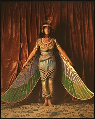 Dancer wearing Egyptian-look costume with wing...