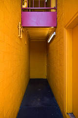 yellow and pink (Herr Bastian) Tags: sanfrancisco door pink blue orange colour brick texture yellow wall canon concrete eos neon floor parking pipes entrance lot structure tokina simplicity knob 1224mm accent fishermenswharf einfachheit 400d aplusphoto colourartaward artlegacy