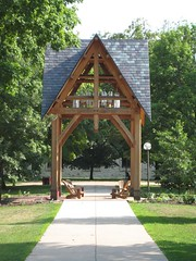 "<p>Title: ""Memorial Chime Tower""<br/>Sculptor: Pete Sandberg and Peter Henrikson<br/><br/>Accessible to Public: yes, outdoors<br/>Location: South Lawn of Buntrock Commons<br/>Ownership: St. Olaf College<br/>Medium: Larch timbers, iron and slate<br/>Dimension: 30 feet tall<br/>Provenance: Gift of Bill Narum and St. Olaf Student Government Association<br/>Year of Installation: 2003<br/>Physical Condition: Good</p>"