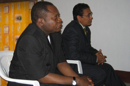 Governor and Minister of mines listen