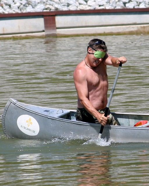 Straining Blindfolded Canoeist