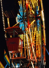 Carnival: Ferris Wheel (StGrundy) Tags: carnival blue atlanta red summer usa colors yellow night dark georgia lights lowlight nikon ride south roswell perspective highcontrast august pointofview southern exposition ferriswheel bigwheel gondolas lowangle onblack artcafe d80 expowheel colorphotoaward peachtreerides superperfectphotographer