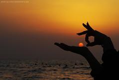 shoot it!! (Mitra Mirshahidi-) Tags: sunset red sea sky orange sun yellow hands iran action iranian       overtheexcellence goldstaraward