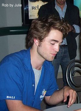 Robert signing autographs.  by Robert Pattinson in Austin.