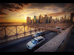 The golden city (Kaj Bjurman) Tags: desktop new york city bridge sunset wallpaper usa ny cars brooklyn buildings eos downtown manhattan 2008 hdr scrapes kaj lanes cs3 photomatix 40d bjurman