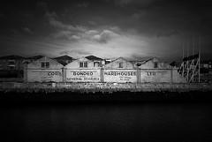 DSC_7213_e5 (staz512) Tags: old blackandwhite bw building port river four typography industrial cork 4 warehouse lee lowkey vignetting czb ltd 18135 staz d80 czarno biale lightfalloff corkbondedwarehouses staz512