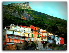 Maratea Porto (proggirl) Tags: houses sea mountain green landscapes rocks colours village harbour basilicata porto maratea bej colorphotoaward goldstaraward ilovemypics overtheshot proggirl