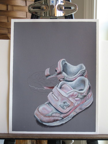 Photo of in progress colored pencil drawing of two pink sneakers.