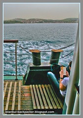 Reading Book Aboard Bosphorus Ferry Cruise at Istanbul