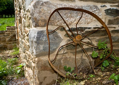 Rusted Wheel By the Spring House