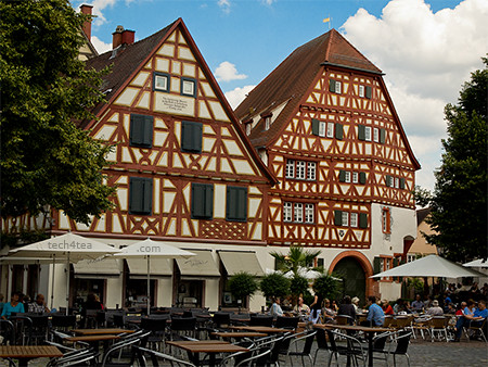 Charming timbered houses at Ladenburg under the summer sky.